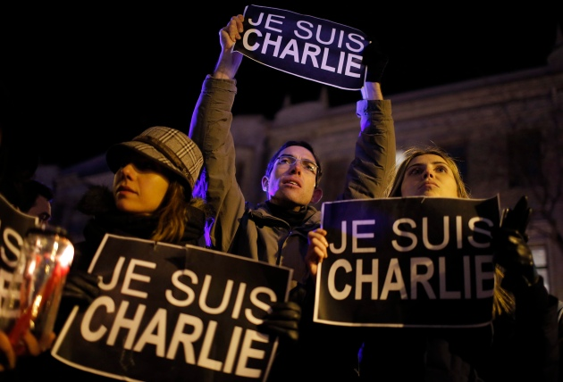 """People hold placards which read """"I am Charlie"""" during a vigil for the victims of Wednesday's shooting at the offices of weekly newspaper Charlie Hebdo in Paris, in Tbilisi"""